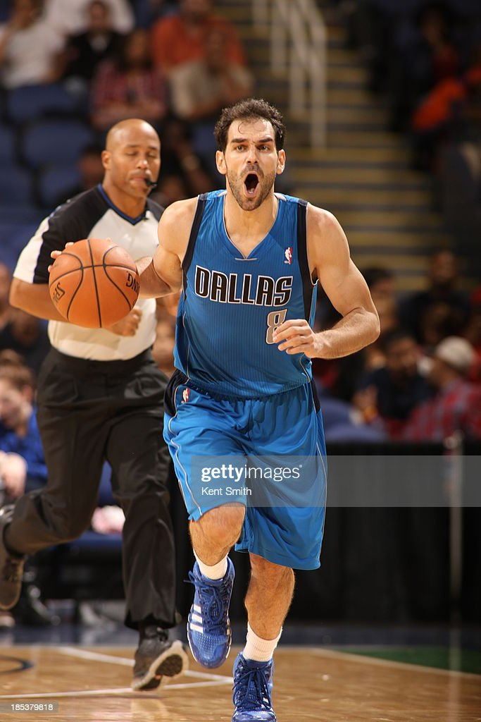 Jose Calderon #8 of the Dallas Mavericks calls out the plays against the Charlotte Bobcats at the Greensboro Coliseum on October 19, 2013 in Greensboro, North Carolina.