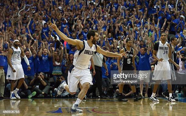 Jose Calderon of the Dallas Mavericks celebrates after Vince Carter of the Dallas Mavericks made the game winning shot against the San Antonio Spurs...