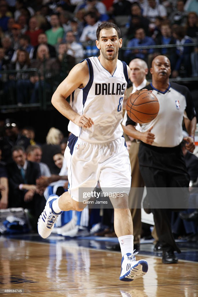 Jose Calderon #8 of the Dallas Mavericks dribbles the ball against the Memphis Grizzlies on December 18, 2013 at the American Airlines Center in Dallas, Texas.
