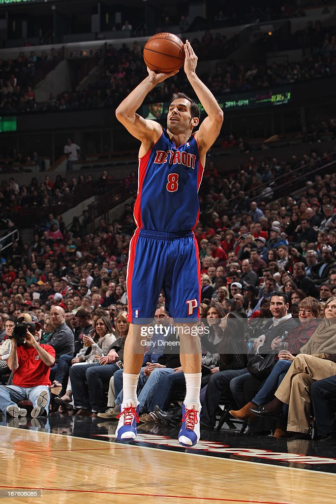 Jose Calderon #8 of the Detroit Pistons shoots a three pointer against the Chicago Bulls on March 31, 2013 at the United Center in Chicago, Illinois.