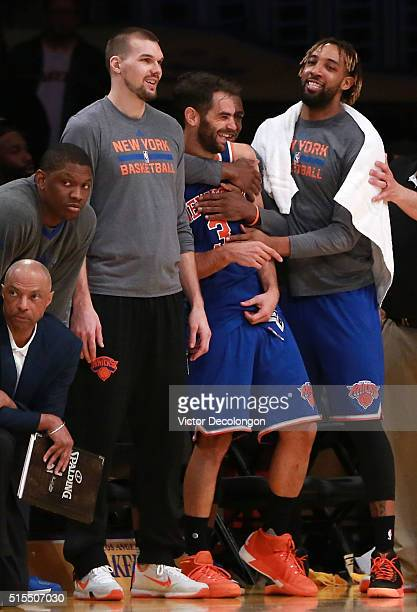 Jose Calderon of the New York Knicks has a laugh with teammates Derrick Willams Lou Amundson and Langston Galloway in the bench area after making a...
