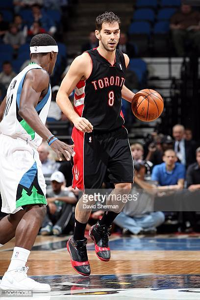 Jose Calderon of the Toronto Raptors dribbles against Jonny Flynn of the Minnesota Timberwolves on March 22, 2010 at the Target Center in...