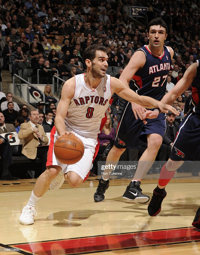 Jose Calderon #8 of the Toronto Raptors drives against ZaZa Pachulia #27 of the Atlanta Hawks during a game on January 12, 2011 at the Air Canada Centre in Toronto, Ontario, Canada.
