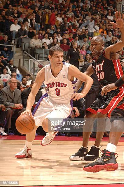 Jose Calderon of the Toronto Raptors drives by Gary Payton of the Miami Heat on November 20 2005 at the Air Canada Centre in Toronto Canada NOTE TO...