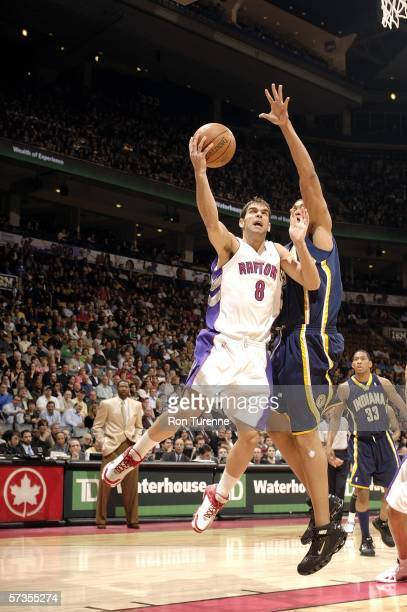 Jose Calderon of the Toronto Raptors drives deep against David Harrison of the Indiana Pacers on April 17 2006 at the Air Canada Centre in Toronto...
