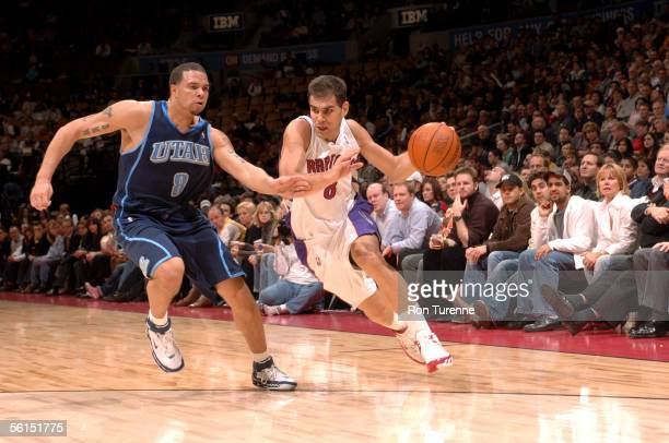 Jose Calderon of the Toronto Raptors drives past Deron Williams of the Utah Jazz on November 11 2005 at the Air Canada Centre in Toronto Canada NOTE...