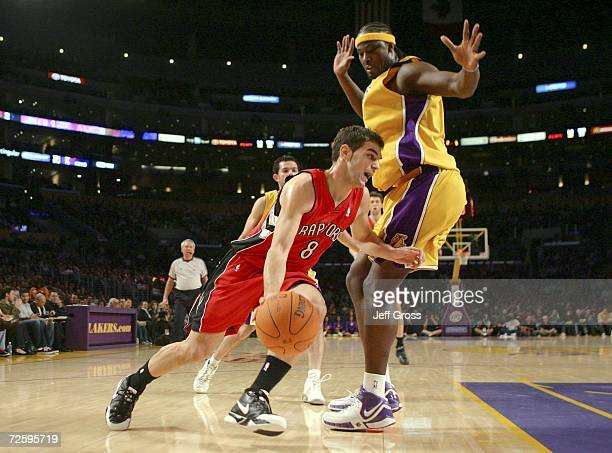 Jose Calderon of the Toronto Raptors drives to the basket past Kwame Brown of the Los Angeles Lakers in the first half November 17 2006 at Staples...
