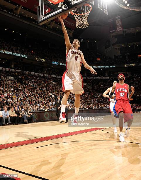 Jose Calderon of the Toronto Raptors finishes the fast break ahead of Richard Hamilton of the Detroit Pistons during a game on March 13 2009 at the...