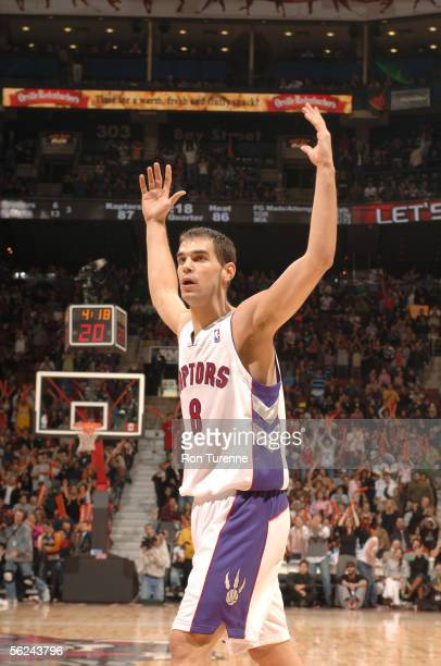 Jose Calderon of the Toronto Raptors gestures to gets the crowd on their feet during a game against the Miami Heat on November 20 2005 at the Air...