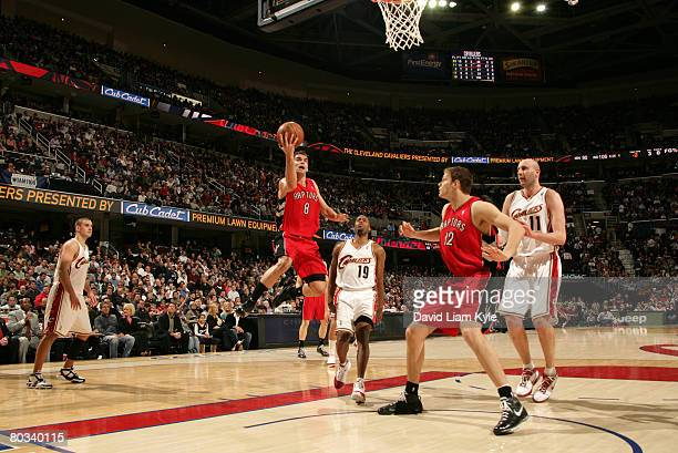 Jose Calderon of the Toronto Raptors glides in for the layup against Damon Jones of the Cleveland Cavaliers at the Quicken Loans Arena March 21, 2008...