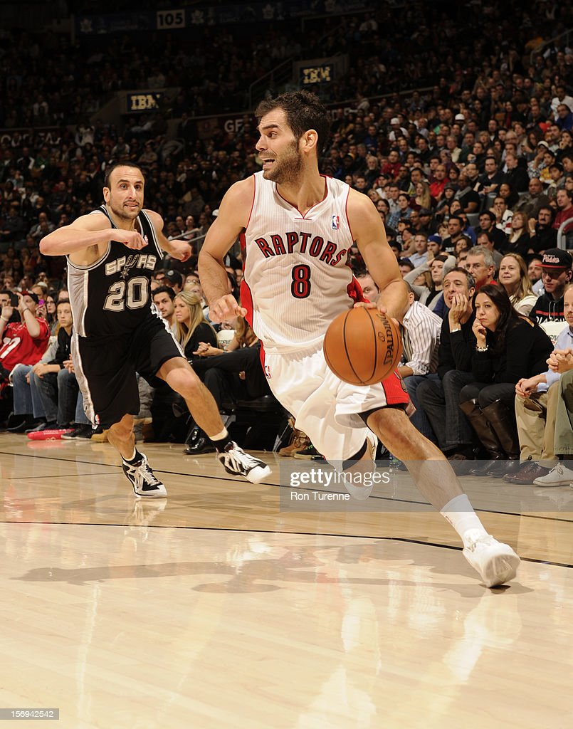 Jose Calderon #8 of the Toronto Raptors goes in for the layup vs the San Antonio Spurs during the game on November 25, 2012 at the Air Canada Centre in Toronto, Ontario, Canada.