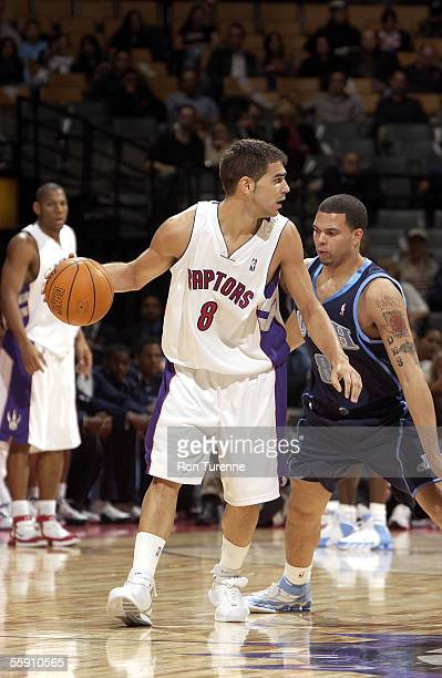 Jose Calderon of the Toronto Raptors looks to make a play against Deron Williams of the Utah Jazz on October 12 2005 at the Air Canada Centre in...