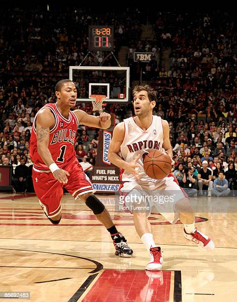 Jose Calderon of the Toronto Raptors looks to move the ball ahead of Derrick Rose of the Chicago Bulls on March 29 2009 at the Air Canada Centre in...