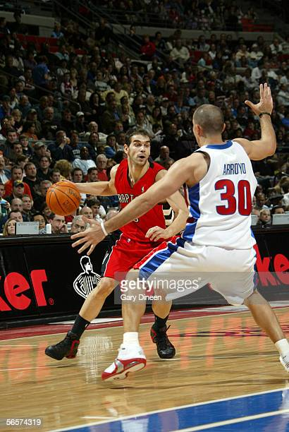 Jose Calderon of the Toronto Raptors moves the ball against Carlos Arroyo of the Detroit Pistons December 27 2005 at the Palace of Auburn Hills in...