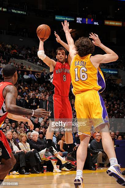 Jose Calderon of the Toronto Raptors passes against Pau Gasol of the Los Angeles Lakers at Staples Center on March 9 2010 in Los Angeles California...