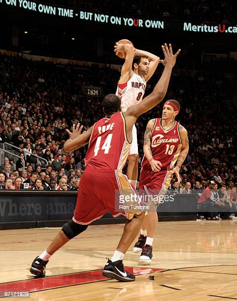 Jose Calderon of the Toronto Raptors passes out of the double team during a game against the Cleveland Cavaliers on February 26 2010 at the Air...
