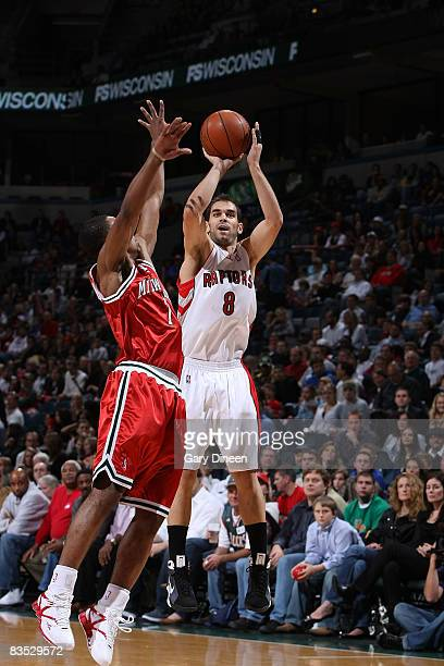 Jose Calderon of the Toronto Raptors shoots against Ramon Sessions of the Milwaukee Bucks on November 1 2008 at the Bradley Center in Milwaukee...