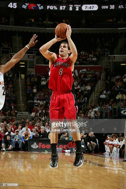 Jose Calderon of the Toronto Raptors shoots against the Cleveland Cavaliers during the game at Quicken Loans Arena on March 7, 2006 in Cleveland,...