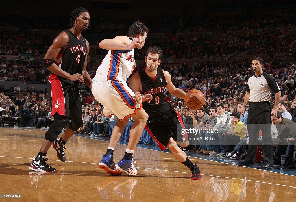 Jose Calderone #8 of the Toronto Raptors drives against Danilo Gallinari #8 of the New York Knicks on January 15, 2010 at Madison Square Garden in New York City.