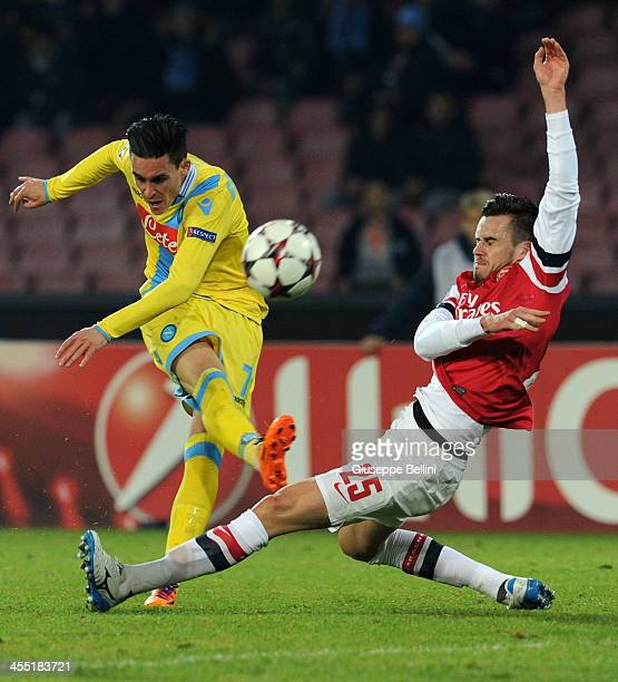 Jose Callejon of Napoli and Carl Jenkinson of Arsenal in action during the UEFA Champions League Group F match between SSC Napoli and Arsenal at...