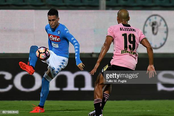 Jose Callejon of NApoli and Haitam Aleesami of Palermo in action during the Serie a match between US Citta di Palermo and SSC Napoli at Stadio Renzo...