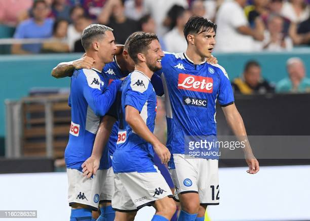 Jose Callejon of Napoli celebrates with teammates after the first goal of their team scored by an own goal of Samuel Umtiti of Barcelona during the...