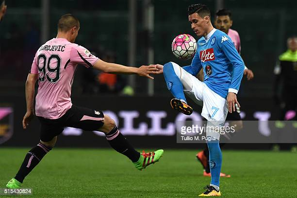 Jose Callejon of Napoli controls the ball as Uros Djurdjevic of Palermo tackles during the Serie A match between US Citta di Palermo and SSC Napoli...