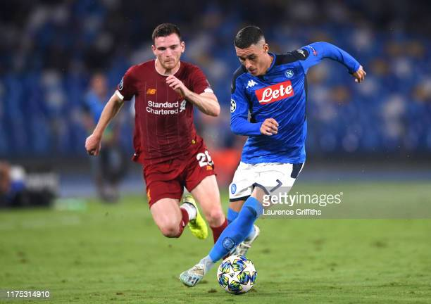 Jose Callejon of Napoli evades Andy Robertson of Liverpool during the UEFA Champions League group E match between SSC Napoli and Liverpool FC at...