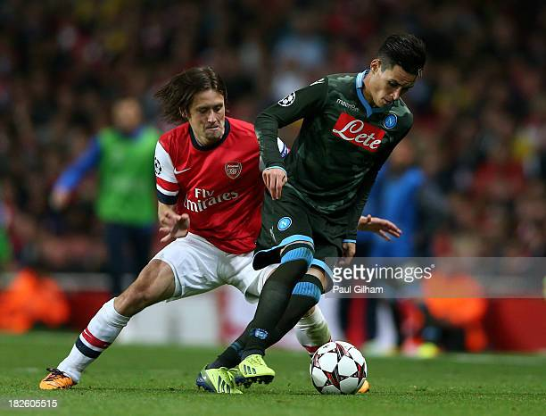 Jose Callejon of Napoli is challenged by Tomas Rosicky of Arsenal during UEFA Champions League Group F match between Arsenal FC and SSC Napoli at...