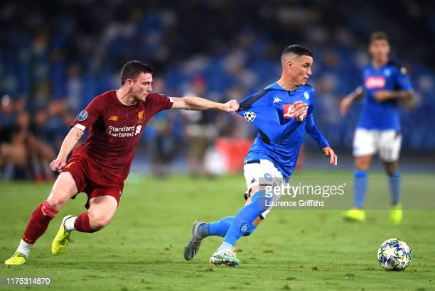 Jose Callejon of Napoli pulls back Andy Robertson of Liverpool during the UEFA Champions League group E match between SSC Napoli and Liverpool FC at...