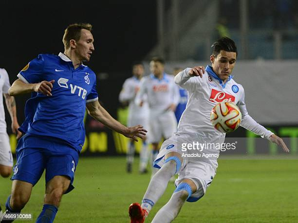 Jose Callejon of Napoli vies with Aleksei Kozlov of Dynamo Moscow during the UEFA Europa League round of 16 second leg football match between Dynamo...