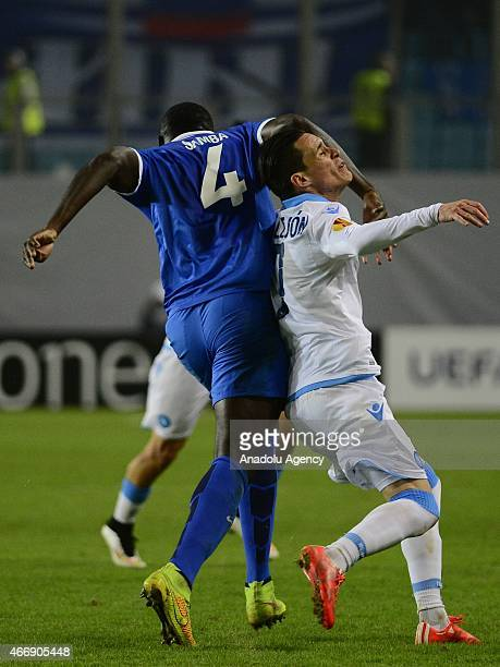 Jose Callejon of Napoli vies with Christopher Samba of Dynamo Moscow during the UEFA Europa League round of 16 second leg football match between...