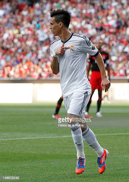 Jose Callejon of Real Madrid celebrates after scoring during the Eusebio Cup match between Benfica and Real Madrid at Estadio da Luz on July 27, 2012...
