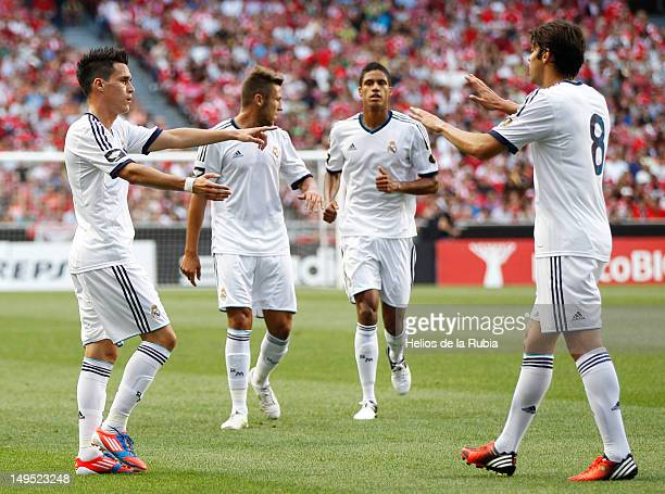 Jose Callejon of Real Madrid celebrates with team-mate Kaka after scoring during the Eusebio Cup match between Benfica and Real Madrid at Estadio da...