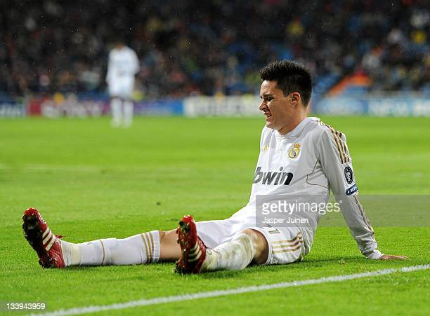 Jose Callejon of Real Madrid grimaces as he sits on the pitch during the UEFA Champions League group D match between Real Madrid and GNK Dinamo...