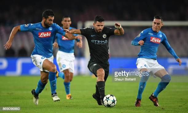 Jose Callejon of SSC Napoli and Raul Albiol of SSC Napoli battle for possession with Sergio Aguero of Manchester City during the UEFA Champions...