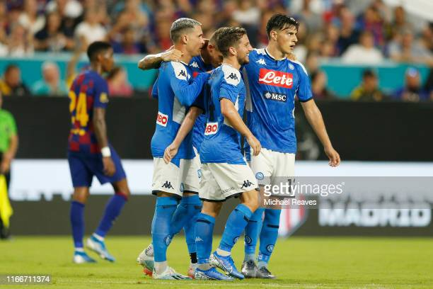 Jose Callejon of SSC Napoli celebrates with teammates after the first goal of their team scored by an own goal of Samuel Umtiti of FC Barcelona...