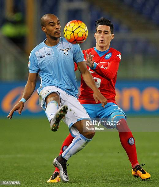 Jose' Callejon of SSC Napoli competes for the ball with Abdoulay Konko of SS Lazio during the Serie A match between SS Lazio and SSC Napoli at Stadio...