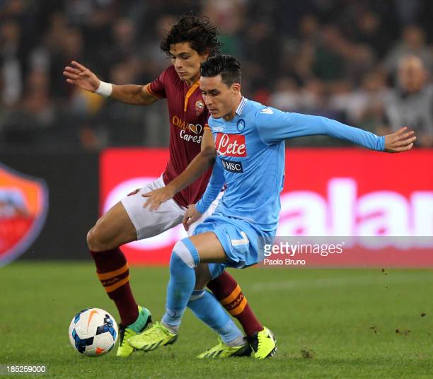 Jose Callejon of SSC Napoli competes for the ball with Dodo of AS Roma during the Serie A match between AS Roma and SSC Napoli at Stadio Olimpico on...
