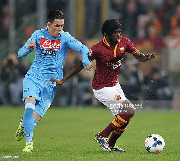 Jose' Callejon of SSC Napoli competes for the ball with Gervinho of AS Roma during the Serie A match between AS Roma and SSC Napoli at Stadio...