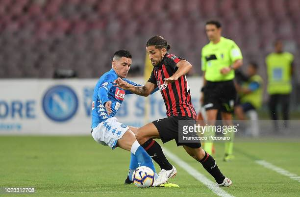 Jose Callejon of SSC Napoli vies Ricardo Rodriguez of AC Milan during the serie A match between SSC Napoli and AC Milan at Stadio San Paolo on August...