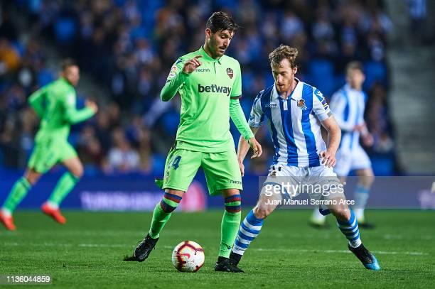 Jose Campana of Levante UD dol David Zurutuza of Real Sociedad during the La Liga match between Real Sociedad and Levante UD at Estadio Anoeta on...