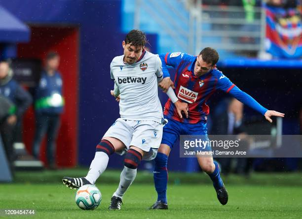 Jose Campana of Levante UD duels for the ball with Sebastian Cristoforo of SD Eibar during the Liga match between SD Eibar SAD and Levante UD at...