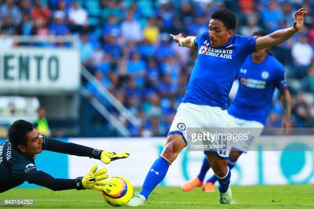 Jose Canales of Lobos BUAP struggles for the ball with Angel Mena of Cruz Azul during the 14th round match between Cruz Azul and Lobos BUAP at Azul...