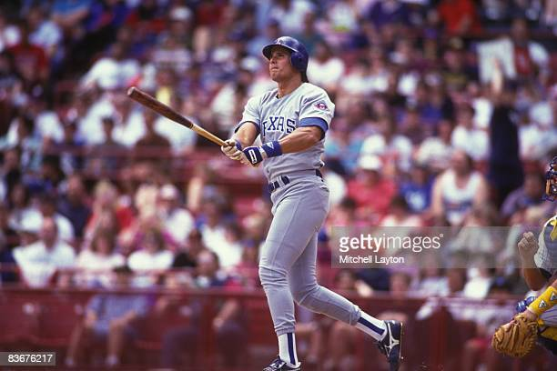 Jose Canceso of the Texas Rangers bats during a baseball game against the Milwaukee Brewers on May 1 1993 at Milwaukee County Stadium in Milwaukee...