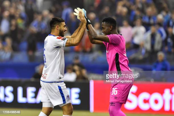Jose Canete and goalkeeper Alex Barrios of CD Olimpia celebrate a victory against the Montreal Impact in the second half during the 1st leg of the...