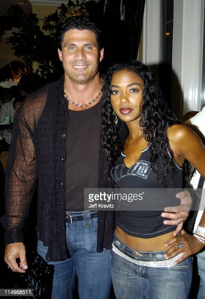 Jose Canseco and Ananda Lewis during BosPokercom $100000 Celebrity Poker Tournament 2004 at Private Residence in Beverly Hills California United...