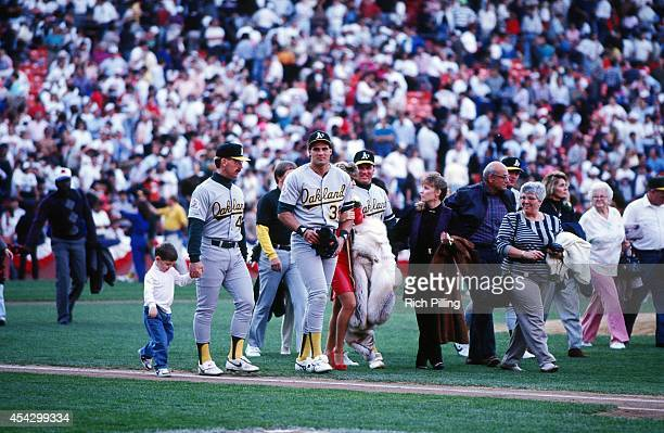 Jose Canseco and members of the Oakland Athletics leave Candlestick Park with their families after the Loma Prieta earthquake hit prior to World...