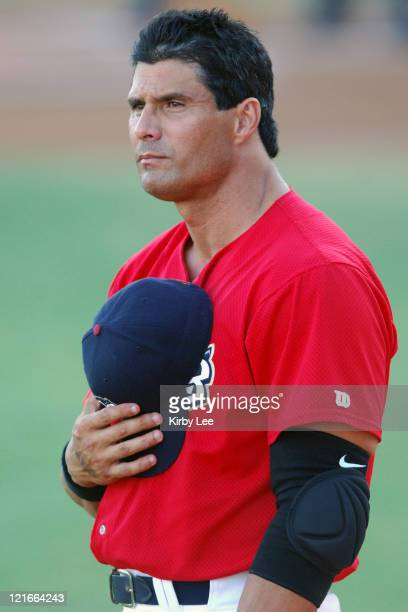Jose Canseco listens to the national anthem before his first game with the Long Beach Armada in the Golden League Baseball game against the Reno...