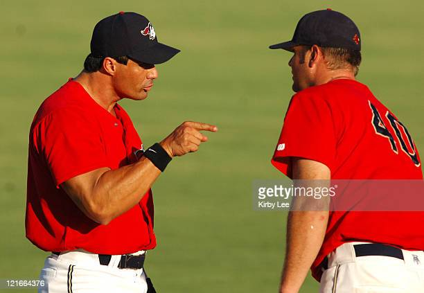 Jose Canseco of the Long Beach Aramada makes a point with teammate Nathan Pudwell before the Golden League Baseball game against the Reno Silver Sox...